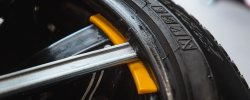 Car tyre lever being used to change tyre