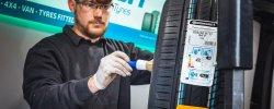 Mobile Tyres 2 U mechanic brushing tyre wall
