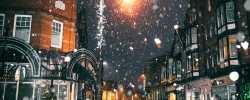 Town streets at nioght during the winter with snow falling Mobile Tyres 2 U